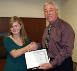Vanessa Ochsner receives her award for Outstanding Learner from Tom Armstrong, President at Eastern Wyoming College.