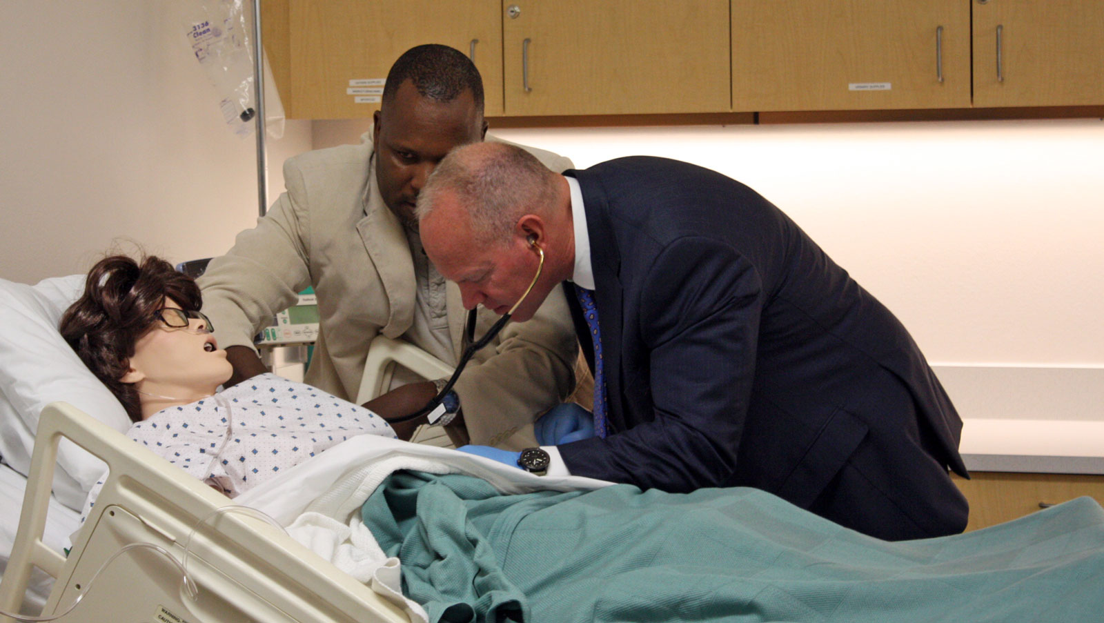 Nursing student Miltone Nyambu demonstrates how to listen to lung sounds to Governor Matt Mead inn the new nursing lab on the Douglas Campus of Eastern Wyoming College